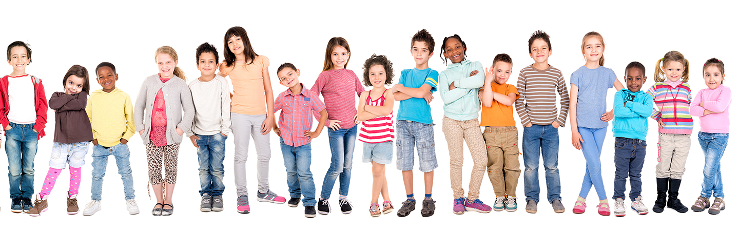 A line of boys and girls of various ages stand beside one another