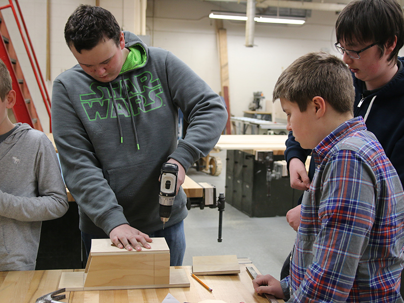 Construction Tech students work on building a wooden box.