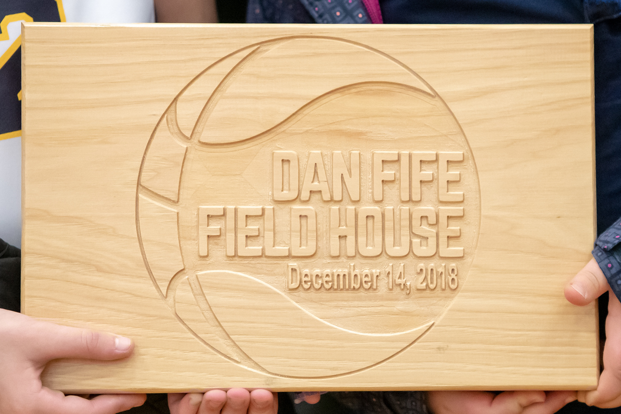 A plaque dedicating the new Dan Fife Field House