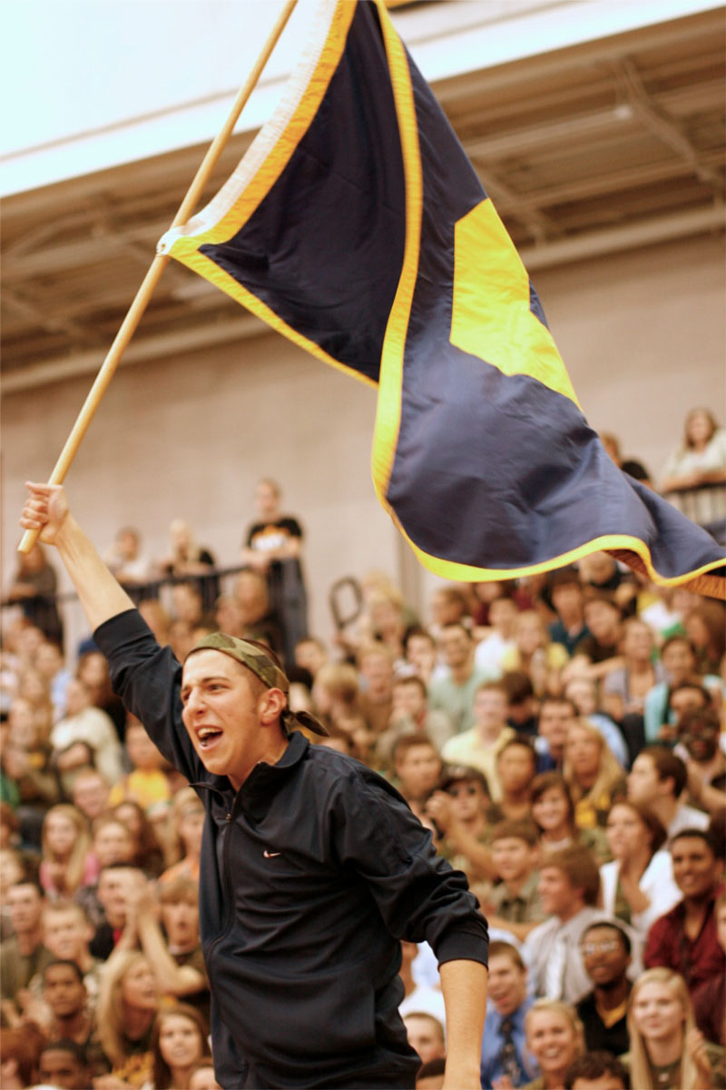 A fan waves the Clarkston flag