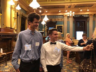 Two students take a selfie on the senate floor