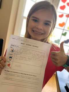 A student gives a thumbs up for SOCKS Week
